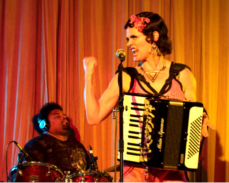 noaccordion-world-music-performance-with-fist-in-air-at-the-jewel-box